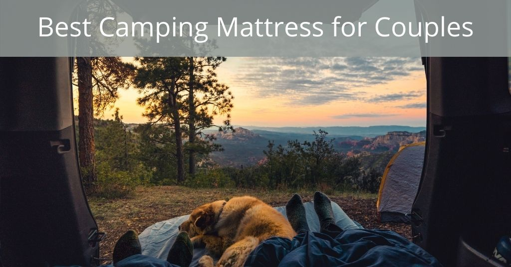Best Camping Mattress for Couples - Two people camping with a dog